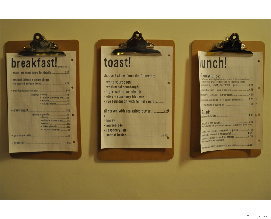 The food menus (all-day breakfast, lunch and toast) hang on the wall.