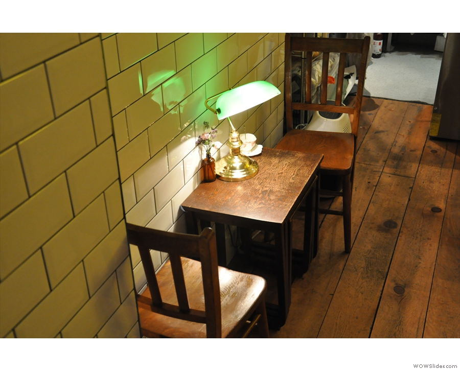 ... and a two-person table against the lefthand wall.