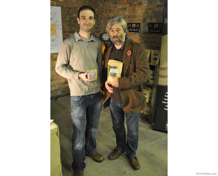 Back inside, this being a coffee festival, there was a lot of coffee swapping going on... Here Grumpy Mule exchanges gifts with J Atkinson...