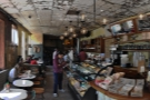 Stepping inside, a panoramic view of the downstairs from just inside the door.