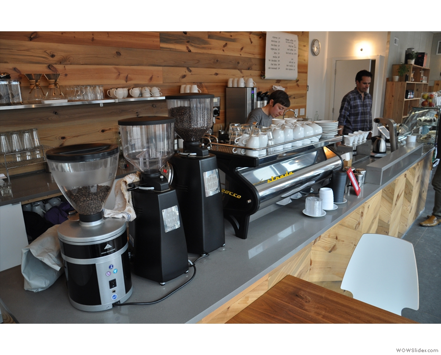 Right, to the coffee. It's a well-stocked counter: grinders, espresso machine, brew bar.