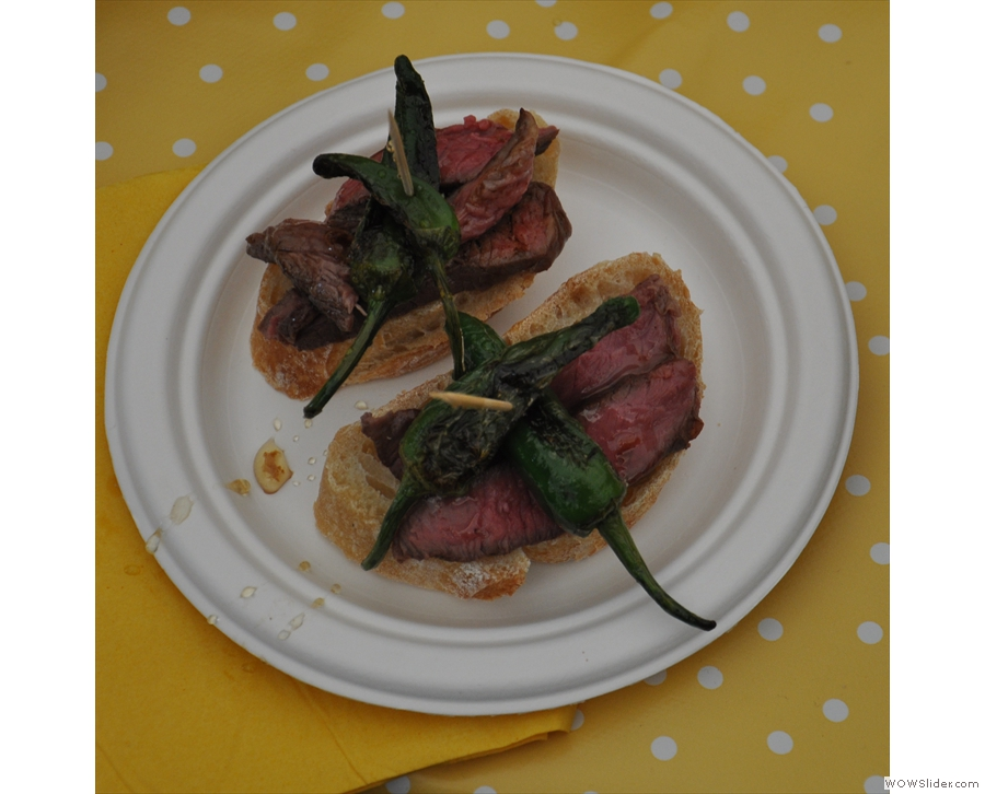 Kate's meaty concoction, with padron peppers skewered to the top...