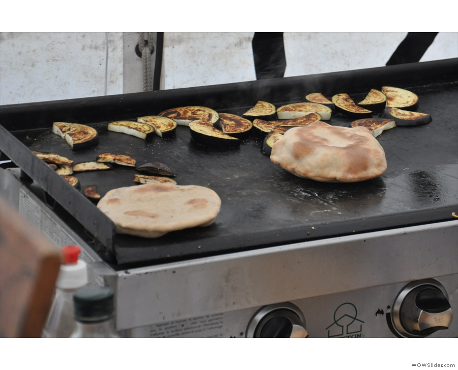 Lovely puffed-up pita-breads and aubergine, warming on the griddle!