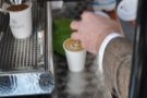 The Americano is almost done and the milk's been added to the flat white. Nice latte art.