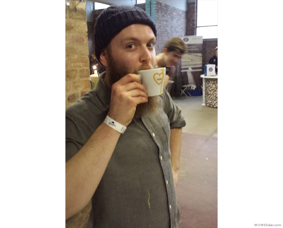 The winner, Sam Binstead, of Sheffield's Upshot Espresso, drinks the evidence!