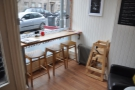 Between the counter and window there's a little seating area with this window bar...