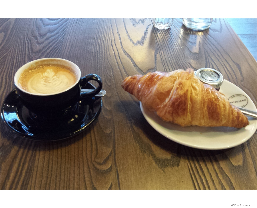 Breakfast: a croissant and flat white.