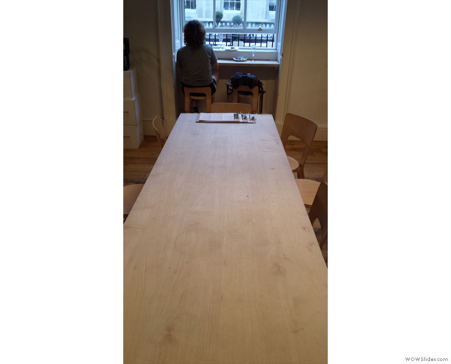 However, what makes this room stand out are the two long, communal tables.
