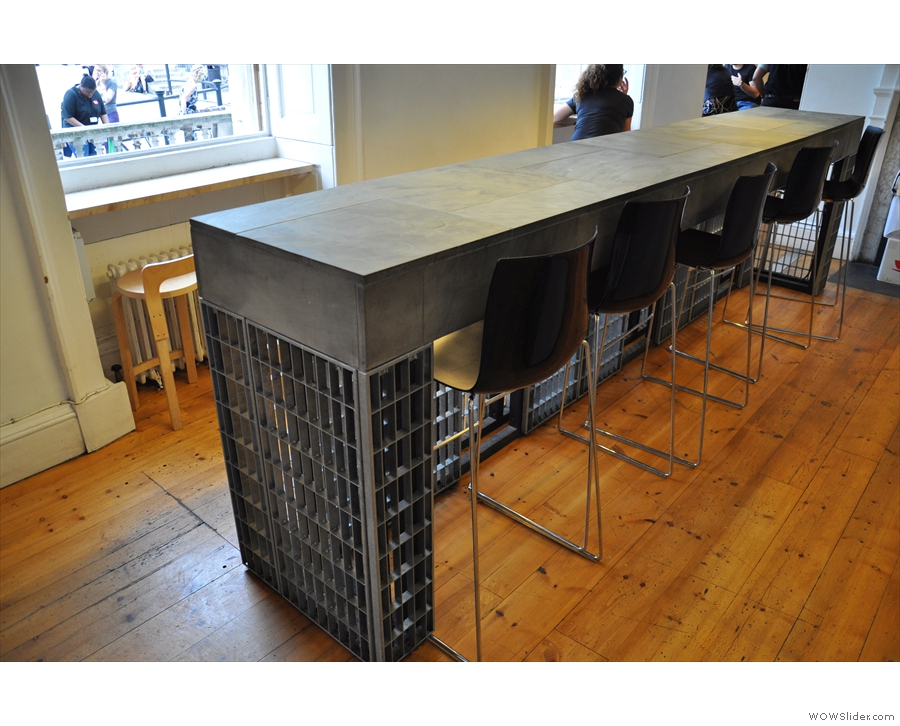 Ths one has plenty of seating too, such as this island table, or the window bars beyond it.