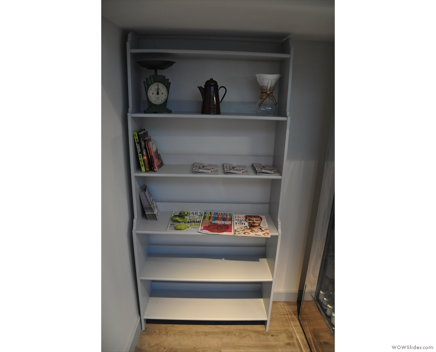There's this neat shelving unit opposite you as you come in the door.