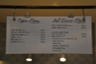 The menus hang up behind the counter. Concise and to the point.