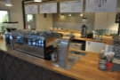 The more typical view of the (very shiny) La Marzocco...