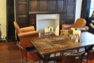 In the centre of the bay, there's this communal table. Best of all is the wonderful fireplace!