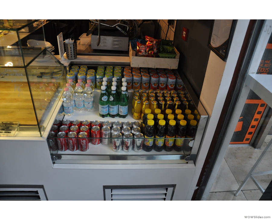 There is also a good selection of soft drinks out front by the food.