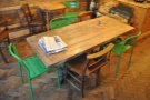 The communal table between the window and counter.