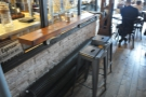 Opposite is the last of the seating, this narrow, two-person bar.