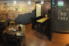 A panoramic view of the cosy room at the back.