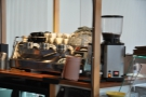 You come in behind the counter, which means you get a good view of the espresso machine!