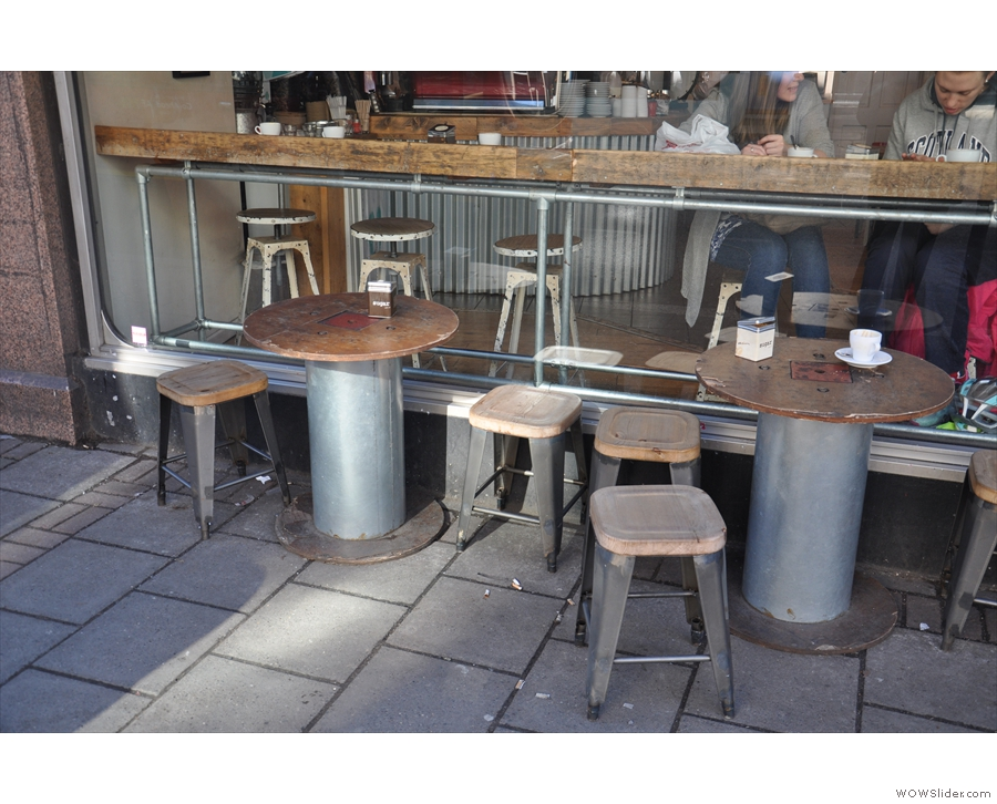 ... or how about one of the tables on the pavement outside?