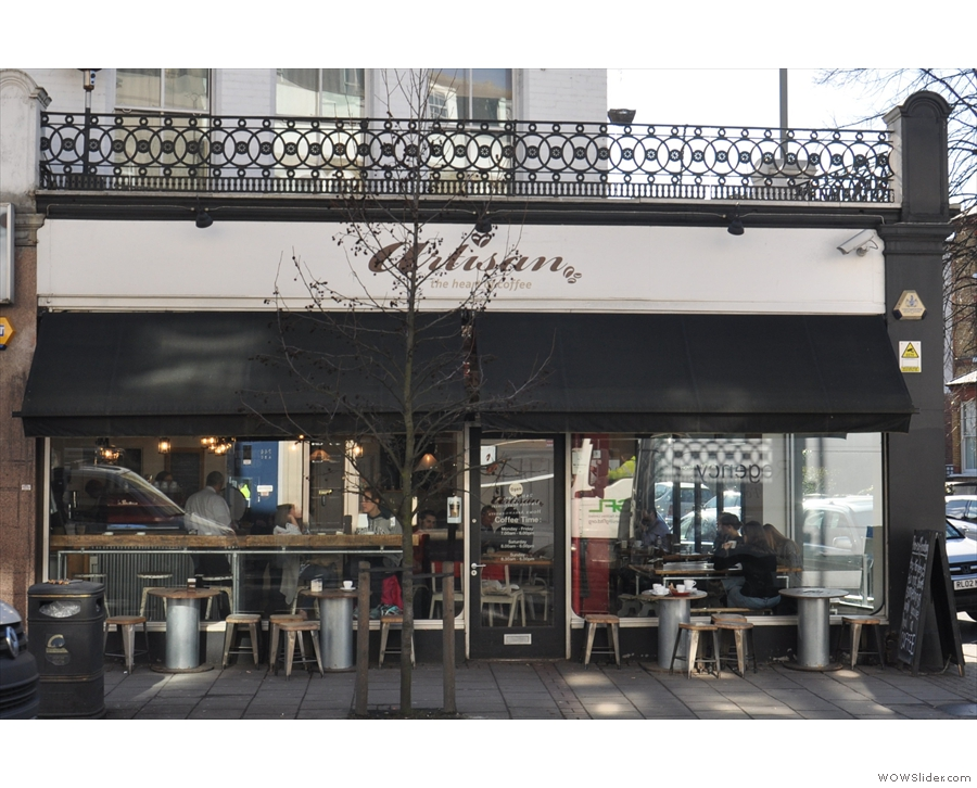 The front of Artisan, complete with outside seating, on Putney's busy Upper Richmond Road.