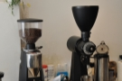 The grinders are to the right, one for the espresso house-blend, and an EK-43 for the rest.