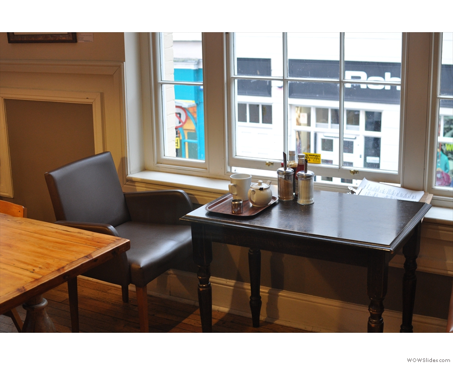 Comfy chairs by the window, looking out onto Broad Street.