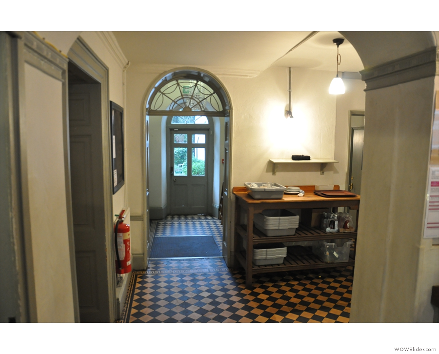 It gives access to two more rooms, the drawing room to the left & scullery to the right.