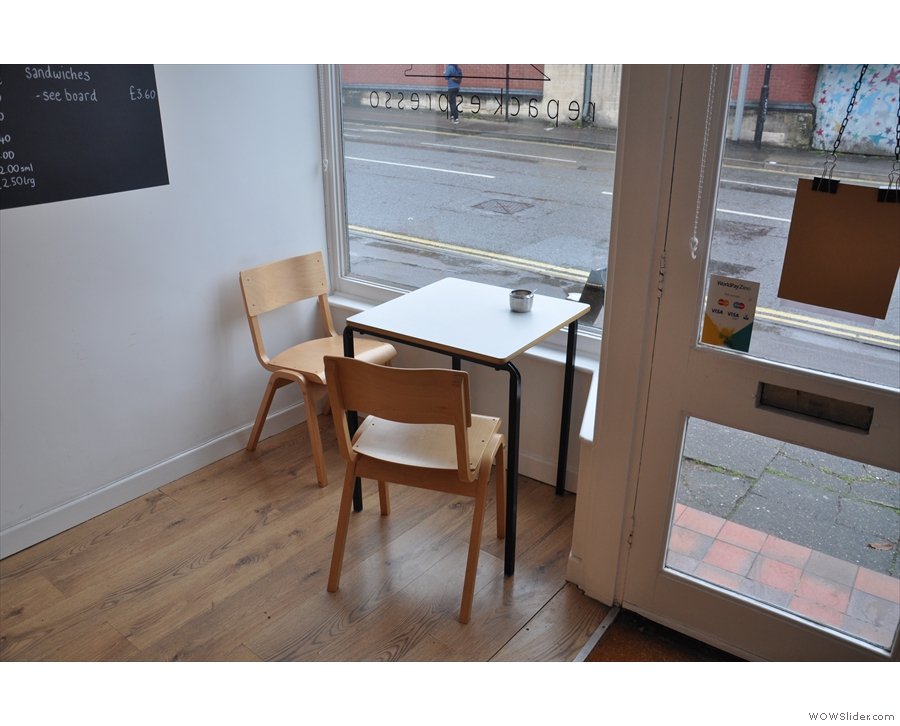 There's this little table to the left of the door as you come in, plus (out of shot) a window bar.