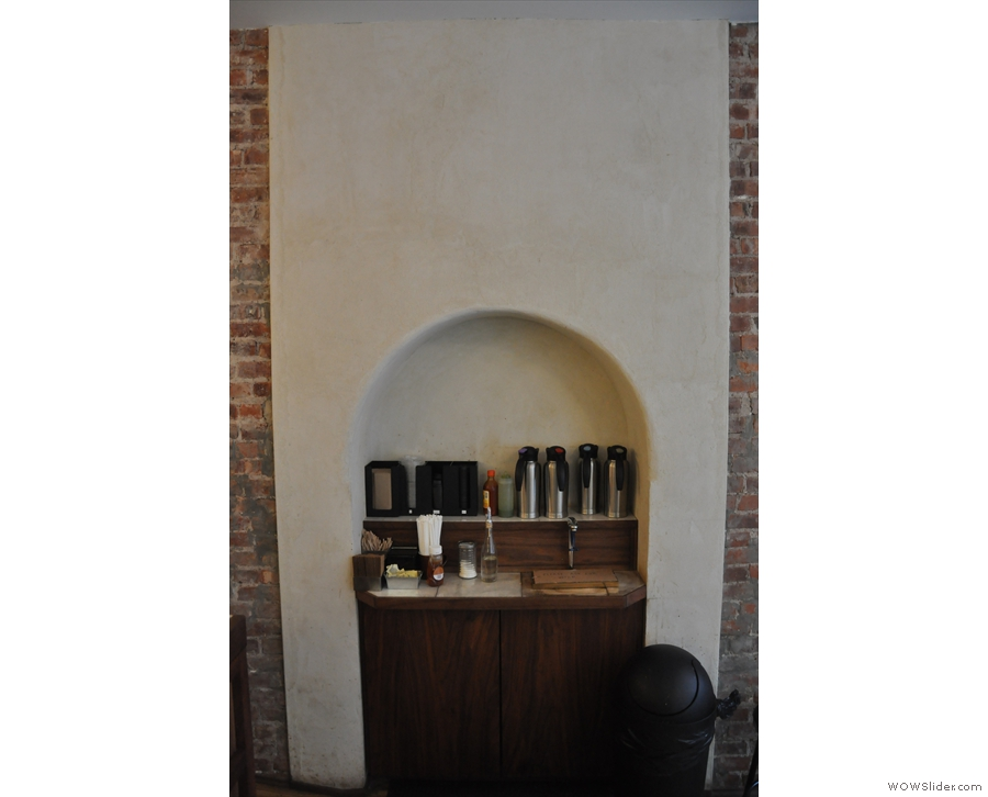 This archway, which was a door into the adjoining store, now holds the takeaway supplies.