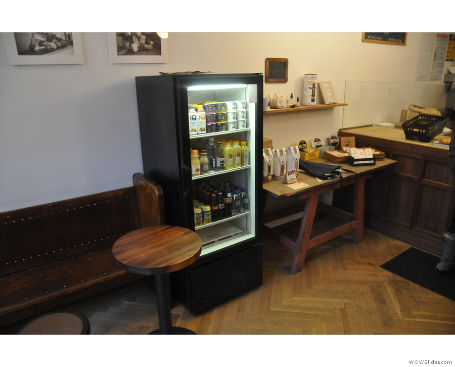 Beyond the seating comes the chiller cabinet and the retail table...