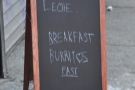 The A-board proudly pronounces the house specialities: Cafe con Leche & breakfast burritos.