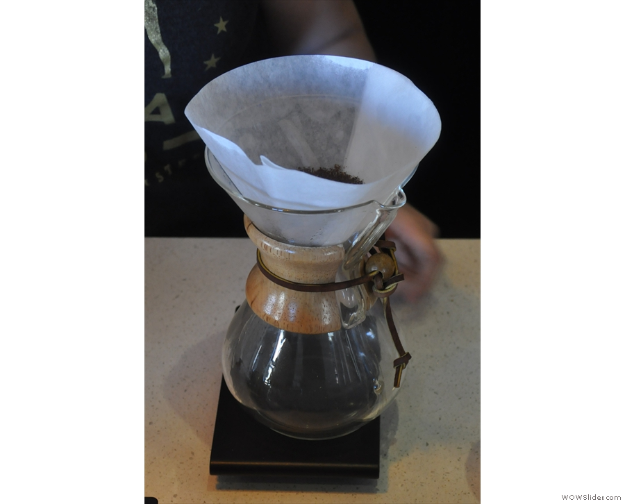 The Chemex is prepared, the beans ground, and then placed in the filter paper.