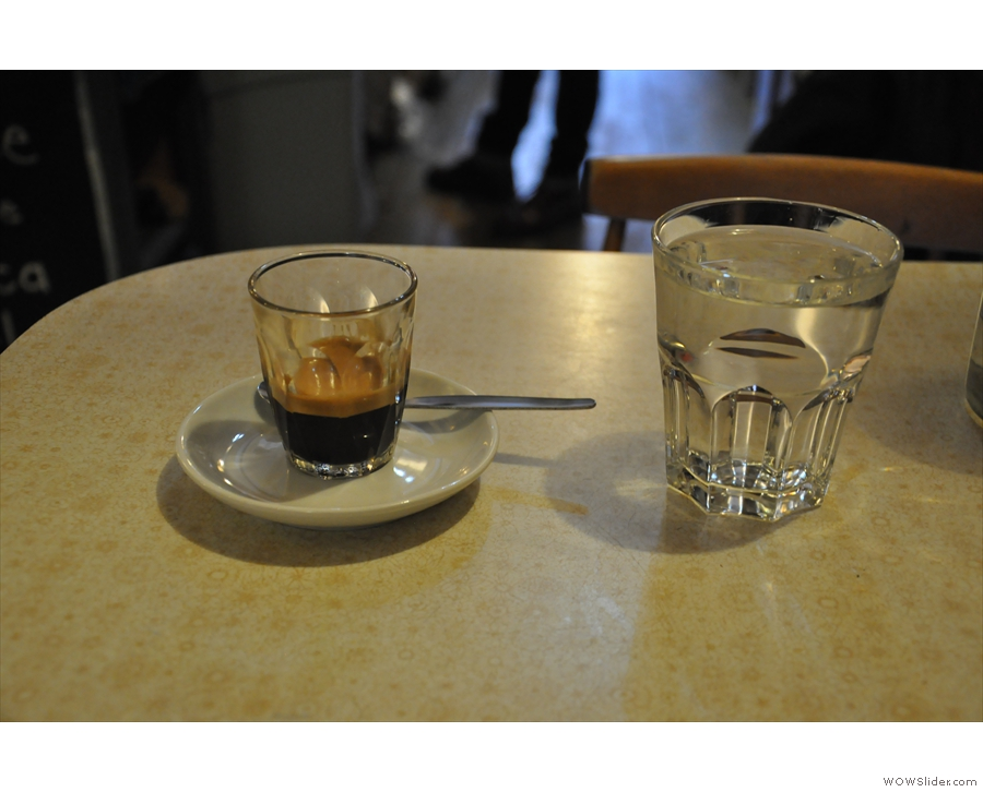 Finally, here's my espresso, along with a glass of water which arrived without asking.