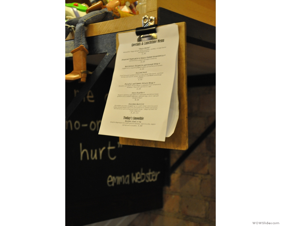 Rather than cluttering up the table, the menus are conveniently hung around the cafe.