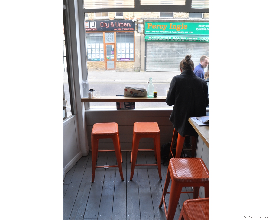 A rare unoccupied pair of stools in the window.