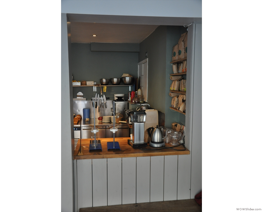 The right-hand third of the counter houses the filter station, with the kitchen behind it.