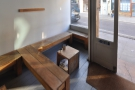 The rest of the seating is along the right-hand wall, between window and counter.