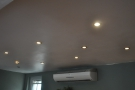 However, the spots in the ceiling behind the counter were...