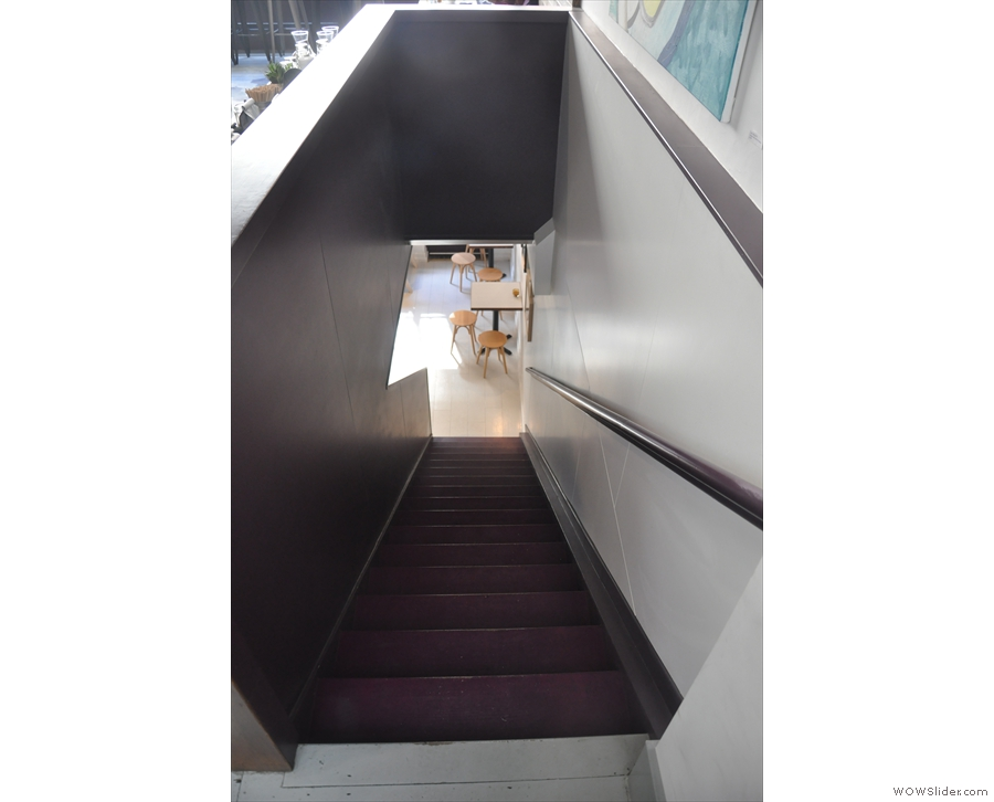 ... standing at the top of the stairs down to the basement.