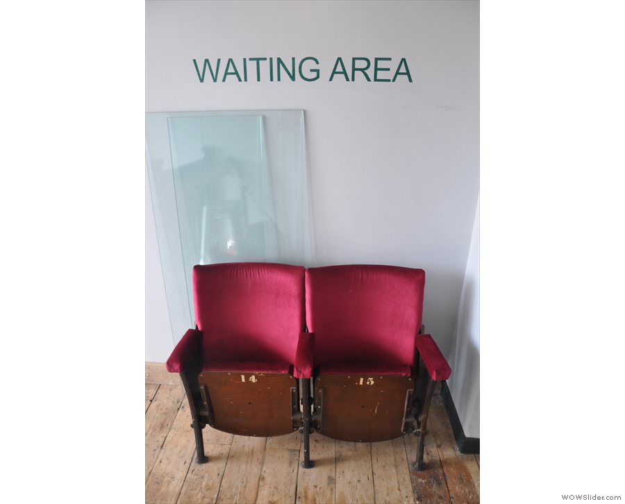 ... where there's a waiting area to your right...
