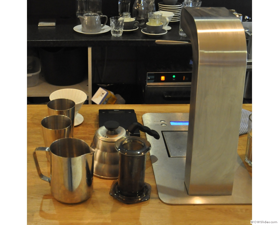 Beyond the espresso machine is the filter station, complete with built-in boiler/tap.