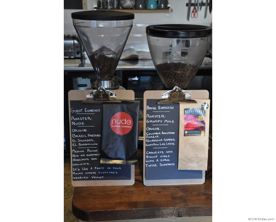 The grinders clearly display their contents, complete with tasting notes and packaging.