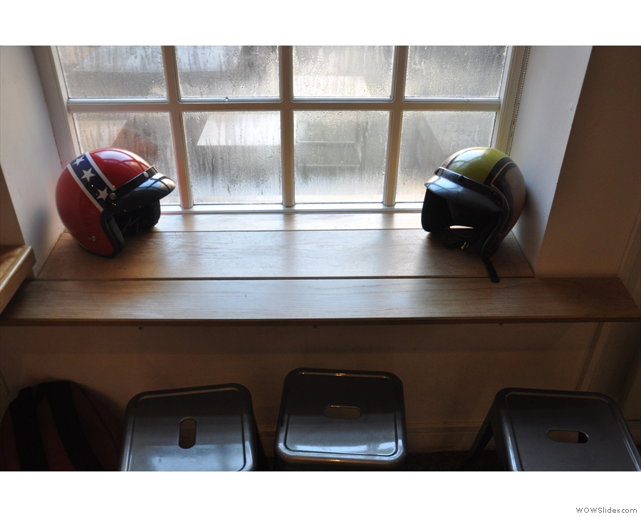 I wondered if someone had left their helmets by the window, but it's part of the bike theme.