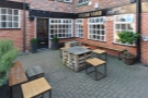The outside seating, an interesting mix of stools, benches and tables, is lovely and sheltered.