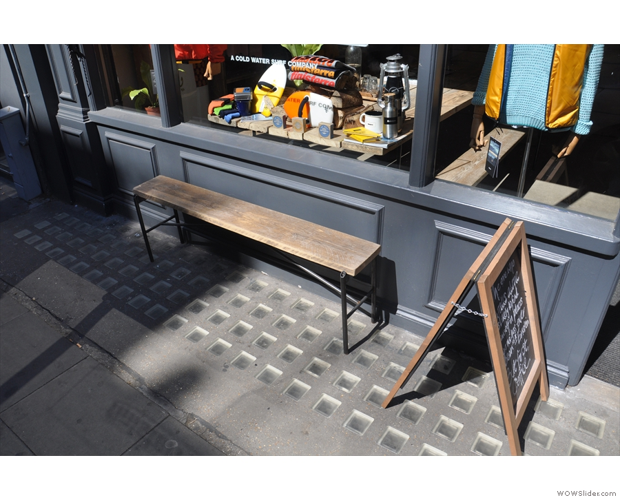 From the outside, it looks every bit the coffee shop, right down to a bench on the pavement.