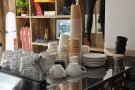 Nice array of cups on the espresso machine.