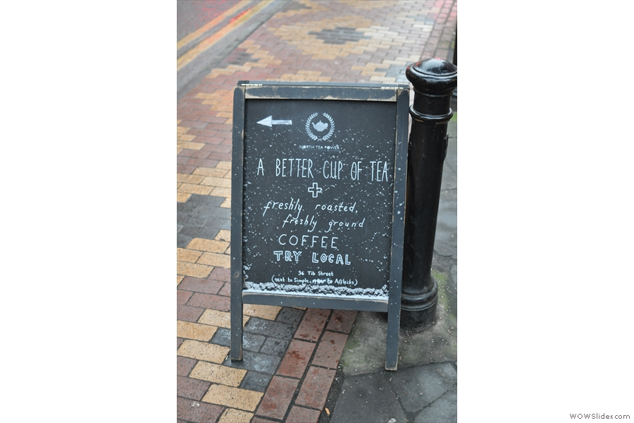 On a cold and snowy Tib Street, there's a welcoming sign, pointing the way...