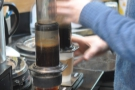 Once they're both full, he pops in the second part of the Aeropress.