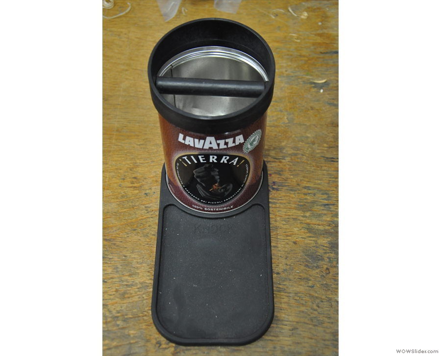 It was designed to fit on top of a standard coffee bean tin. Clever idea.