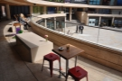 More tables and concrete benches at the front of the balcony.